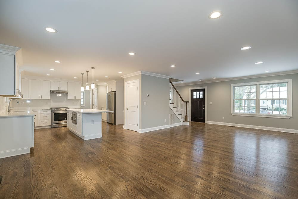 staging of dining room, living room and kitchen open floor before