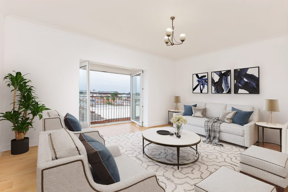 living room staged in white and blue with an open balcony